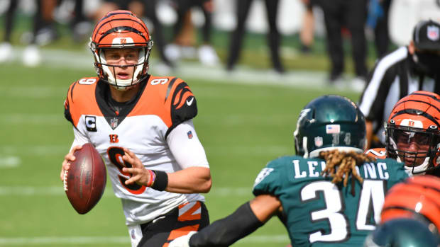 Sep 27, 2020; Philadelphia, Pennsylvania, USA; Cincinnati Bengals quarterback Joe Burrow (9) looks for a receiver in the end zone against the Philadelphia Eagles during the first quarter at Lincoln Financial Field. Mandatory Credit: Eric Hartline-USA TODAY Sports