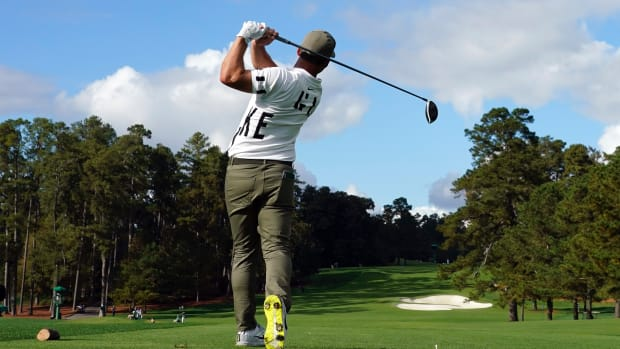 Paul Casey plays his shot from the eighth tee during the first round of The Masters golf tournament at Augusta National GC.