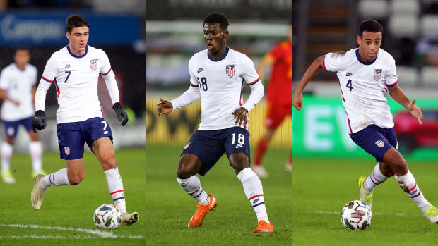 USA's Gio Reyna, Yunus Musah and Tyler Adams