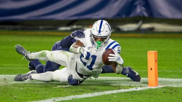 Indianapolis Colts running back Nyheim Hines reaches for the end zone to score one of his two touchdowns in Thursday's 34-17 road win over the Tennessee Titans.