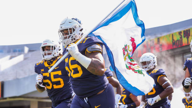 West Virginia Mountaineers defensive lineman Darius Stills (56) leads his team onto the field prior to their game against the Eastern Kentucky Colonels at Mountaineer Field at Milan Puskar Stadium.