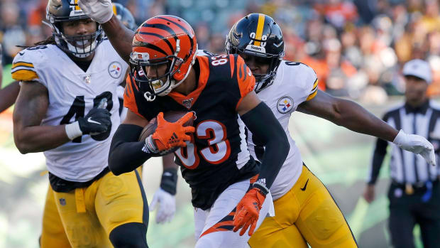 Cincinnati Bengals wide receiver Tyler Boyd (83) runs from Pittsburgh Steelers cornerback Mike Hilton (28) in the third quarter of the NFL Week 12 game between the Cincinnati Bengals and the Pittsburgh Steelers at Paul Brown Stadium in downtown Cincinnati on Sunday, Nov. 24, 2019. The Steelers dealt the Bengals loss No. 11, 16-10, at home. Pittsburgh Steelers At Cincinnati Bengals