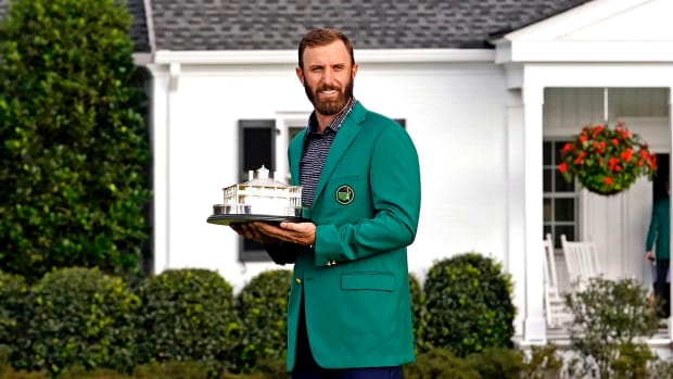 Dustin Johnson celebrates with the Masters Trophy after winning The Masters golf tournament
