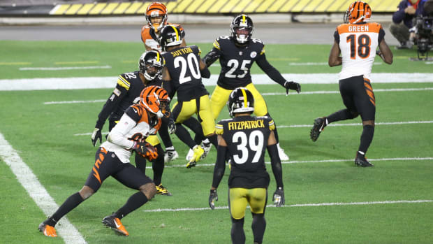 Nov 15, 2020; Pittsburgh, Pennsylvania, USA; Cincinnati Bengals wide receiver Tee Higgins (85) scores on a two yard pass reception against the Pittsburgh Steelers during the second quarter at Heinz Field. Mandatory Credit: Charles LeClaire-USA TODAY Sports