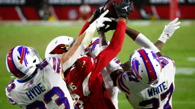 Arizona Cardinals DeAndre Hopkins (10) catches a game-winning touchdown catch over Bill's Tre'Davious White (27) and Micah Hyde (23) with two seconds left in the fourth quarter at State Farm Stadium in Glendale, Ariz. on Nov. 15, 2020.