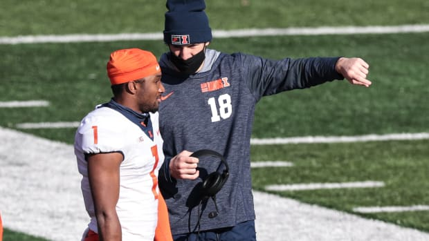 Illinois Fighting Illini quarterback Isaiah Williams (1) talks with quarterback Brandon Peters (18) during the first half against the Rutgers Scarlet Knights at SHI Stadium.