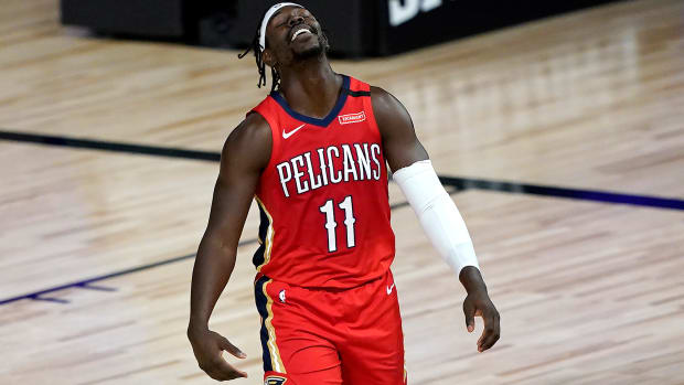 New Orleans Pelicans' Jrue Holiday reacts during the first half of an NBA basketball game.
