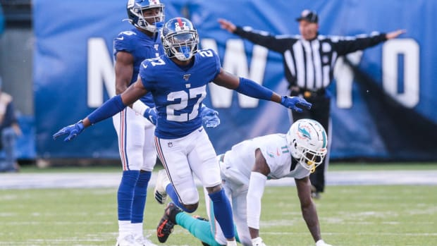 Dec 15, 2019; East Rutherford, NJ, USA; New York Giants cornerback Deandre Baker (27) reacts after breaking up a pass intended for Miami Dolphins wide receiver DeVante Parker (11) during the first half at MetLife Stadium. Mandatory Credit: Vincent Carchietta-USA TODAY Sports