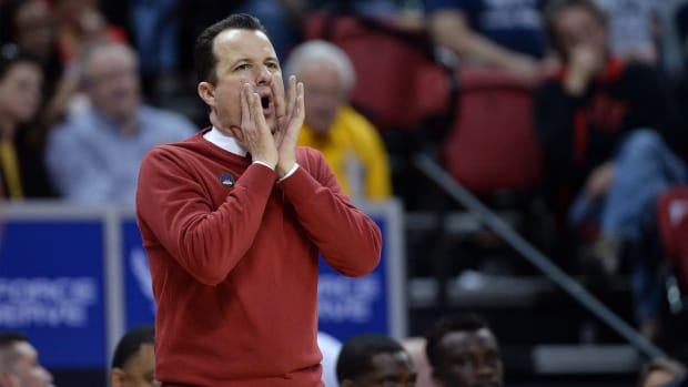 Mar 5, 2020; Las Vegas, Nevada, USA; New Mexico Lobos head coach Paul Weir coaches from the bench during the second half of a Mountain West Conference tournament game against the Utah State Aggies at Thomas Mack Center. Mandatory Credit: Orlando Ramirez-USA TODAY Sports