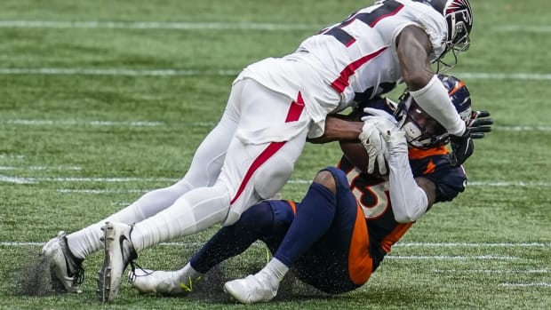 Atlanta Falcons safety Keanu Neal (22) is penalized for a hit on Denver Broncos wide receiver KJ Hamler (13) during the second half at Mercedes-Benz Stadium.
