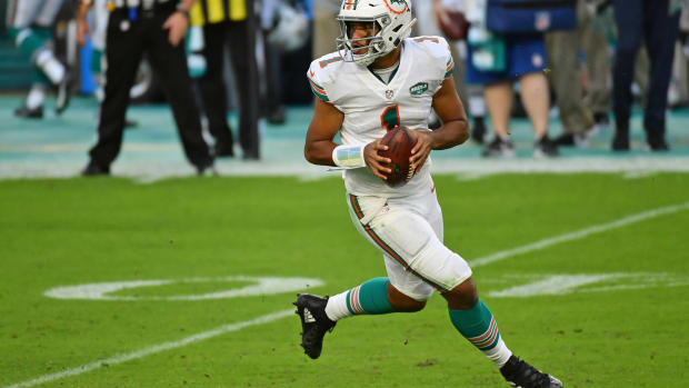 Miami Dolphins quarterback Tua Tagovailoa (1) drops back with the ball against the Los Angeles Chargers during the first half at Hard Rock Stadium.