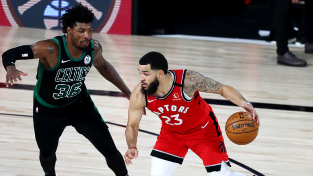 Sep 7, 2020; Lake Buena Vista, Florida, USA; Toronto Raptors guard Fred VanVleet (23) dribbles the ball against Boston Celtics guard Marcus Smart (36) during the second half of game five of the second round in the 2020 NBA Playoffs at ESPN Wide World of Sports Complex.