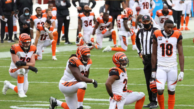 Nov 22, 2020; Landover, Maryland, USA; Cincinnati Bengals players kneel on the field after Bengals quarterback Joe Burrow (not pictured) injured his left knee against the Washington Football Team in the third quarter at FedExField. Mandatory Credit: Geoff Burke-USA TODAY Sports