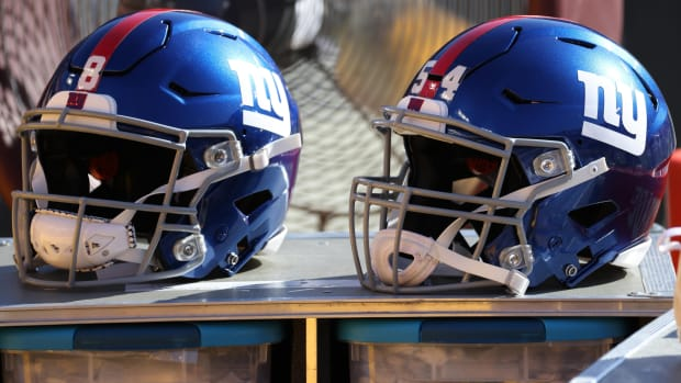 Nov 8, 2020; Landover, Maryland, USA; A view of the helmets of New York Giants quarterback Daniel Jones (8) and Giants inside linebacker Blake Martinez (54) resting on equipment case on the sidelines against the Washington Football Team at FedExField.