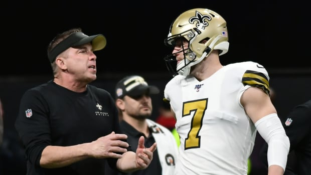 New Orleans Saints Head Coach Sean Payton talks to New Orleans Saints Quarterback Taysom Hill (7) during warmups before the NFL game between the New Orleans Saints and the Atlanta Falcons on November 28, 2019, at Mercedes-Benz Stadium in Atlanta, GA.
