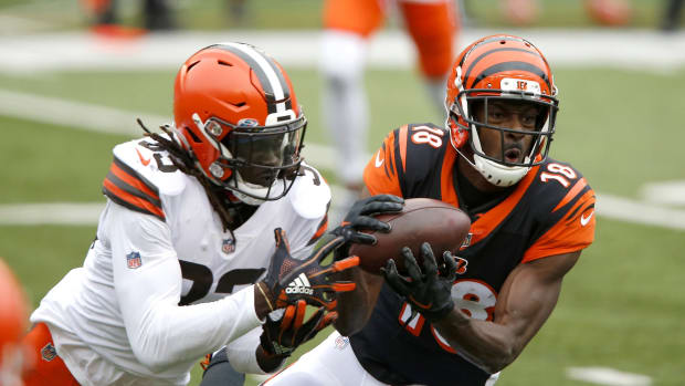 Oct 25, 2020; Cincinnati, Ohio, USA; Cincinnati Bengals wide receiver A.J. Green (18)makes the catch as Cleveland Browns defensive back Ronnie Harrison (33)defends late in the fourth quarter at Paul Brown Stadium. Mandatory Credit: Joseph Maiorana-USA TODAY Sports