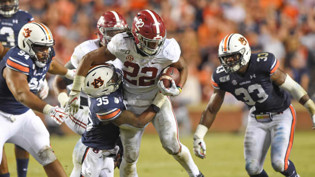 Alabama's Najee Harris runs against Auburn