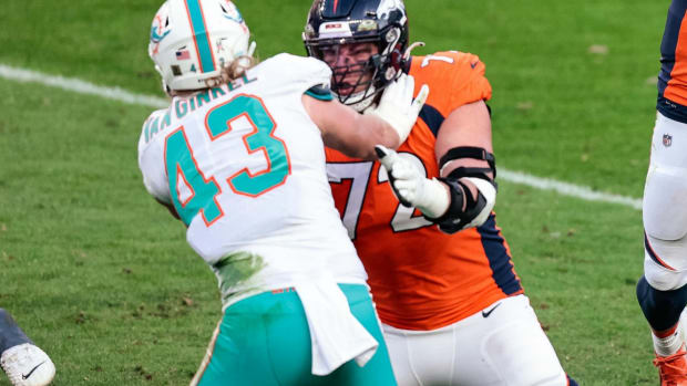 Denver Broncos quarterback Drew Lock (3) attempts a pass as offensive tackle Garett Bolles (72) defends against Miami Dolphins linebacker Andrew Van Ginkel (43) in the third quarter at Empower Field at Mile High.