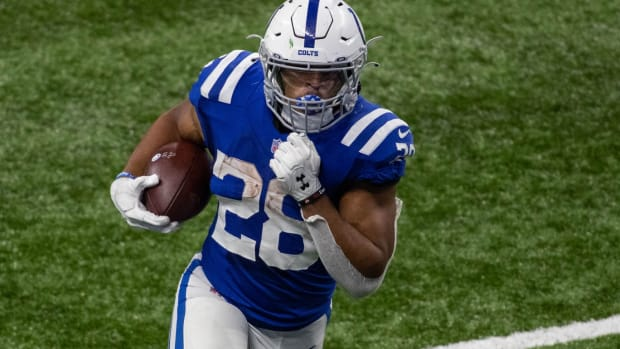 Indianapolis Colts rookie running back Jonathan Taylor looks for space in Sunday's overtime home win over the Green Bay Packers.
