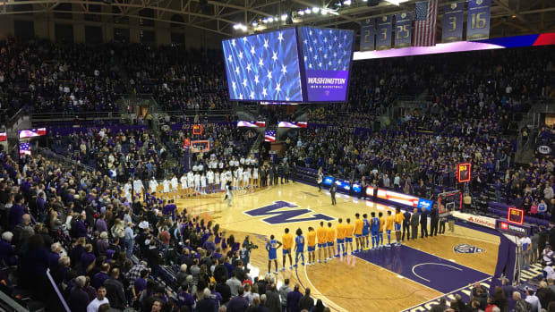 Teams stand for the national anthem at Alaska Airlines Arena.