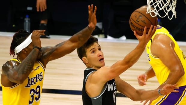Aug 13, 2020; Lake Buena Vista, Florida, USA; Bogdan Bogdanovic #8 of the Sacramento Kings goes up for a shot against Dwight Howard #39 of the Los Angeles Lakers during the second quarter at The Field House at ESPN Wide World Of Sports Complex on August 13, 2020 in Lake Buena Vista, Florida. Mandatory Credit: Kevin C. Cox/Pool Photo-USA TODAY Sports