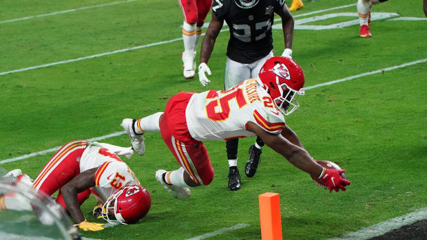 Nov 22, 2020; Paradise, Nevada, USA; Kansas City Chiefs running back Clyde Edwards-Helaire (25) scores a touchdown against the Las Vegas Raiders during the second half at Allegiant Stadium. Mandatory Credit: Kirby Lee-USA TODAY Sports