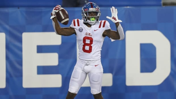 Mississippi Rebels wide receiver Elijah Moore (8) celebrates after a touchdown in overtime against Kentucky at Kroger Field. Mandatory Credit: Katie Stratman-USA TODAY Sports