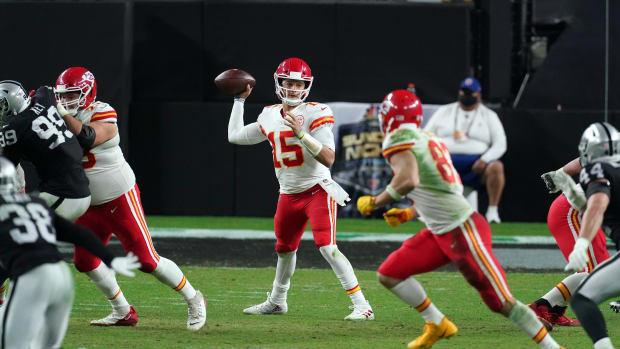 Nov 22, 2020; Paradise, Nevada, USA; Kansas City Chiefs quarterback Patrick Mahomes (15) throws against the Las Vegas Raiders during the second half at Allegiant Stadium. Mandatory Credit: Kirby Lee-USA TODAY Sports