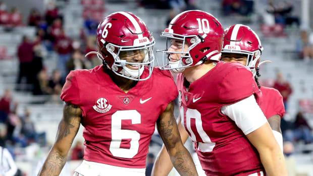 Alabama's DeVonta Smith and Mac Jones celebrate a touchdown