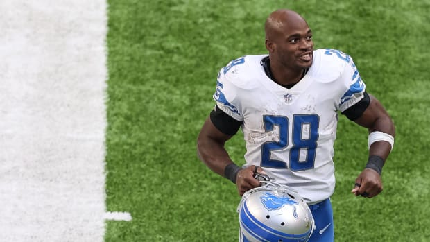 Nov 8, 2020; Minneapolis, Minnesota, USA; Detroit Lions running back Adrian Peterson (28) exits the field following the game against the Minnesota Vikings at U.S. Bank Stadium. Mandatory Credit: Harrison Barden-USA TODAY Sports