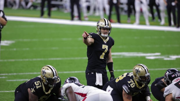New Orleans Saints quarterback Taysom Hill (7) at the line against the Atlanta Falcons during the second half at the Mercedes-Benz Superdome.