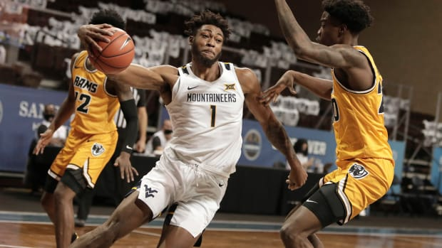 SIOUX FALLS, SD - NOVEMBER 26: Derek Culver #1 of the West Virginia Mountaineers drives into Hason Ward #20 of the Virginia Commonwealth Rams during the Bad Boy Mowers Crossover Classic at the Sanford Pentagon in Sioux Falls, SD.