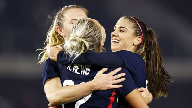 USWNT's Kristie Mewis celebrates a goal with her sister, Sam, and Alex Morgan
