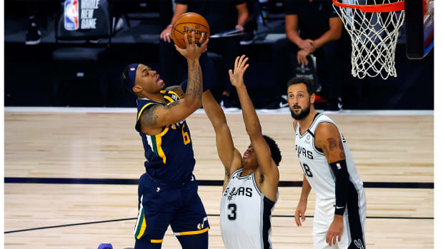 Aug 13, 2020; Lake Buena Vista, Florida, USA; Rayjon Tucker #6 of the Utah Jazz scores against Keldon Johnson #3 of the San Antonio Spurs during the third quarter at The Field House at ESPN Wide World of Sports Complex. Mandatory Credit: Kevin C. Cox/Pool Photo-USA TODAY Sports