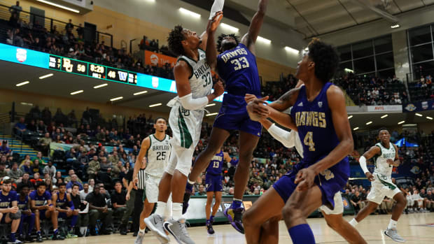 The Huskies beat Baylor 67-64 a year ago, but Isaiah Stewart (33) and Jaden McDaniels (4) are in the NBA now.
