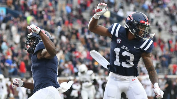 Mississippi wide receiver Braylon Sanders (13) and Mississippi wide receiver Jonathan Mingo (1) celebrate a touchdown against Mississippi State Bulldogs at Vaunt-Hemingway Stadium in Oxford, Miss. on Saturday, Nov. 28, 2020.  (Bruce Newman)
