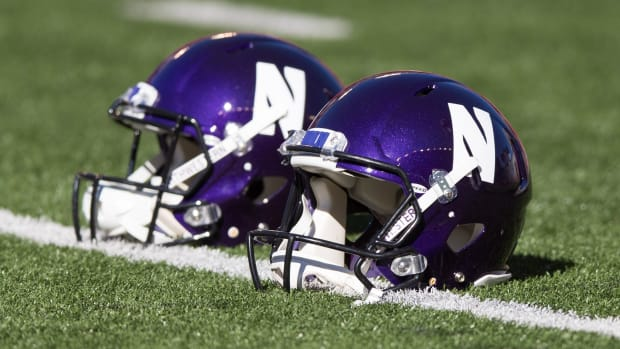 Sep 30, 2017; Madison, WI, USA; Northwestern Wildcats helmets on the field prior to the game against the Wisconsin Badgers at Camp Randall Stadium.