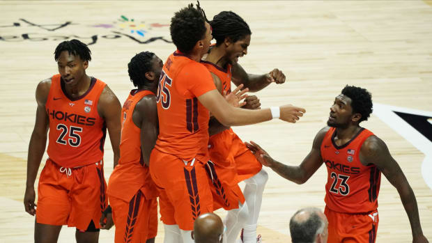 Virginia Tech Hokies guard Cartier Diarra (2) and his teammates react after a play against the Villanova Wildcats in the second half at Mohegan Sun Arena.