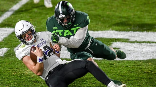 Michigan State's Jacub Panasiuk, right, tackles Northwestern's quarterback Peyton Ramsey during the third quarter