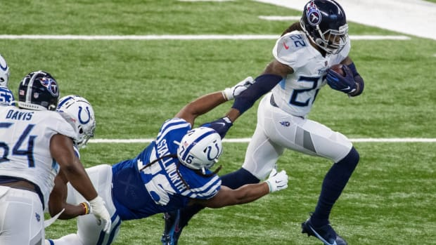 Tennessee Titans running back Derrick Henry stiff-arms past Indianapolis Colts defensive tackle Taylor Stallworth in Sunday's road win at Lucas Oil Stadium. Henry scored three rushing TDs in the first half.