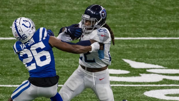 Derrick Henry stiff-arms Rock Ya-Sin during Week 12 win over Colts