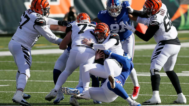 Cincinnati Bengals quarterback Brandon Allen (8) is sacked in the first quarter of the NFL Week 12 game between the Cincinnati Bengals and the New York Giants at Paul Brown Stadium in Cincinnati on Sunday, Nov. 29, 2020. The game was tied at 10 going into halftime. New York Giants At Cincinnati Bengals© Sam Greene via Imagn Content Services, LLC