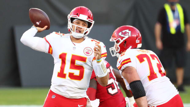 Kansas City Chiefs quarterback Patrick Mahomes (15) moves out to throw as offensive tackle Eric Fisher (72) provides coverage against Tampa Bay Buccaneers outside linebacker Shaquil Barrett (58)