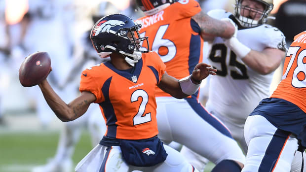Denver Broncos quarterback Kendall Hinton (2) throws the ball against the New Orleans Saints in the second quarter at Empower Field at Mile High.