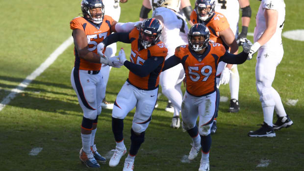 Denver Broncos outside linebacker Bradley Chubb (55) celebrates his sack with outside linebacker Malik Reed (59) and defensive end DeMarcus Walker (57) in the first quarter against the New Orleans Saints at Empower Field at Mile High.