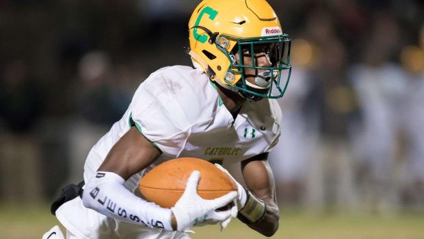 Damarius Mcghee (6) carries the ball during the Catholic vs Milton football game at Milton High School on Friday, Nov. 1, 2019. Catholic Vs Milton Football