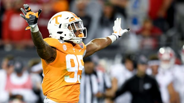 Jan 2, 2020; Jacksonville, Florida, USA; Tennessee Volunteers linebacker Kivon Bennett (95) reacts during the fourth quarter against the Indiana Hoosiers at TIAA Bank Field.
