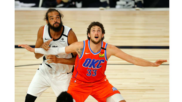 Aug 14, 2020; Lake Buena Vista, Florida, USA; Mike Muscala #33 of the Oklahoma City Thunder and Joakim Noah #55 of the LA Clippers battle for position during the third quarter at The Field House at ESPN Wide World of Sports Complex.