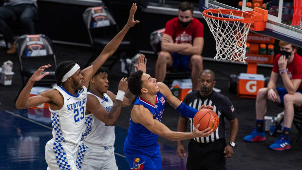 Dec 1, 2020; Indianapolis, IN, USA; Kansas Jayhawks forward Jalen Wilson (10) shoots the ball against Kentucky Wildcats forward Isaiah Jackson (23) in the second half at Bankers Life Fieldhouse.