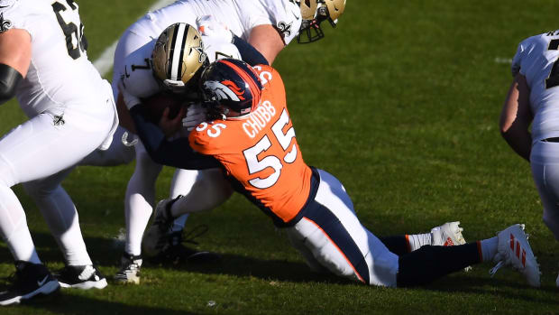 Denver Broncos outside linebacker Bradley Chubb (55) sacks New Orleans Saints quarterback Taysom Hill (7) in the first quarter at Empower Field at Mile High.